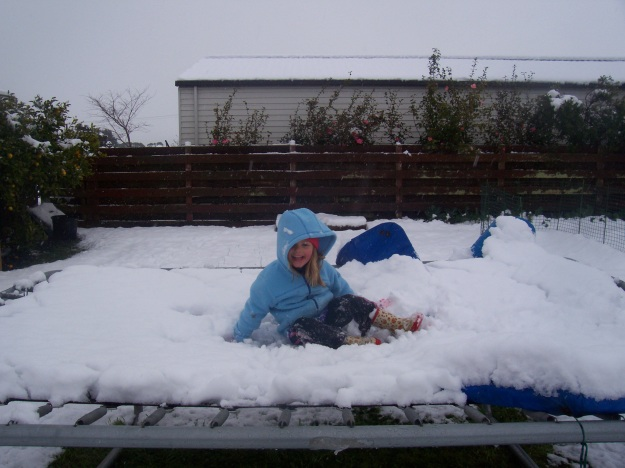 My daughter enjoying her first snow in 2011